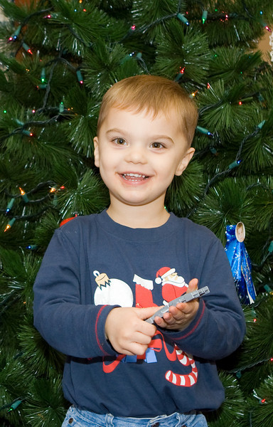 K.C. wants to place his Thomas train and tracks under the tree.