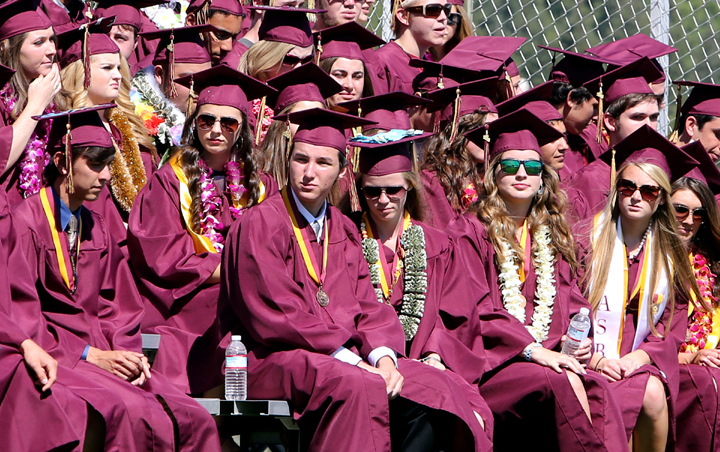 . Dozens of graduates pack the bleachers at Scotts Valley High on Wednesday during the 2013 graduation ceremony. (Kevin Johnson/Sentinel)