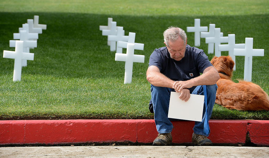 . Jim Travis, of Redlands bows his head in prayer during a memorial service for fallen service members was held Friday May 17, 2013 in front of the Memorial Chapel at the univsersity. The ceremony featured a special tribute to Keith Taylor, a University of Redlands alumnus and father of a University of Redlands student. He was killed serving in Iraq. (Rick Sforza/Staff photographer, Redlands Daily Facts)
