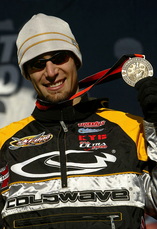 . Carl Kuster #47 of Westlock, Alberta, Canada shows off his bronze medal from the Snowmobile Hillcross during the VIII Winter X Games on January 27, 2004 at the Buttermilk Resort in Aspen, Colorado.  (Photo by Doug Pensinger/Getty Images)