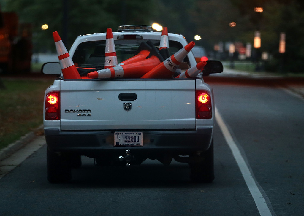 . A U.S. Park Service truck carries away road closure cones on the morning after a bipartisan bill was passed by the House and the Senate to reopened the government and raise the debt limit, on October 17, 2013 in Washington, DC.   (Photo by Mark Wilson/Getty Images)