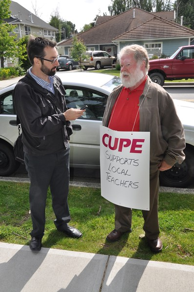 CUPE 1091 president Colin Pawson being interviewed by South Delta Leader reporter Adrian MacNair at Delta Secondary.JPG