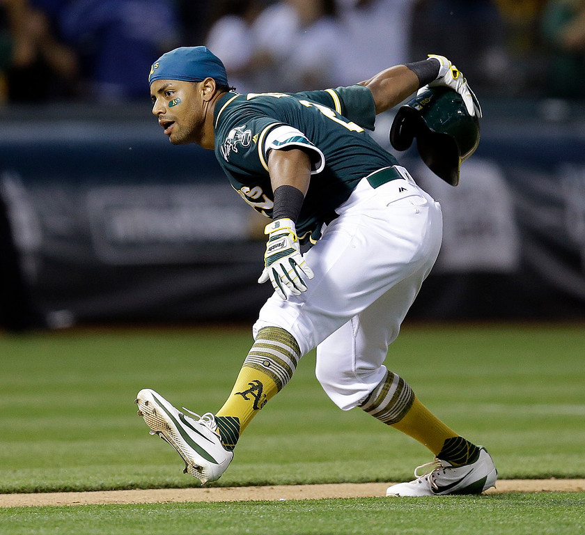 . Oakland Athletics\' Khris Davis celebrates after hitting a two-run home run off Cleveland Indians\' Bryan Shaw during the ninth inning of a baseball game Saturday, July 15, 2017, in Oakland, Calif. The A\'s won 5-3. (AP Photo/Ben Margot)
