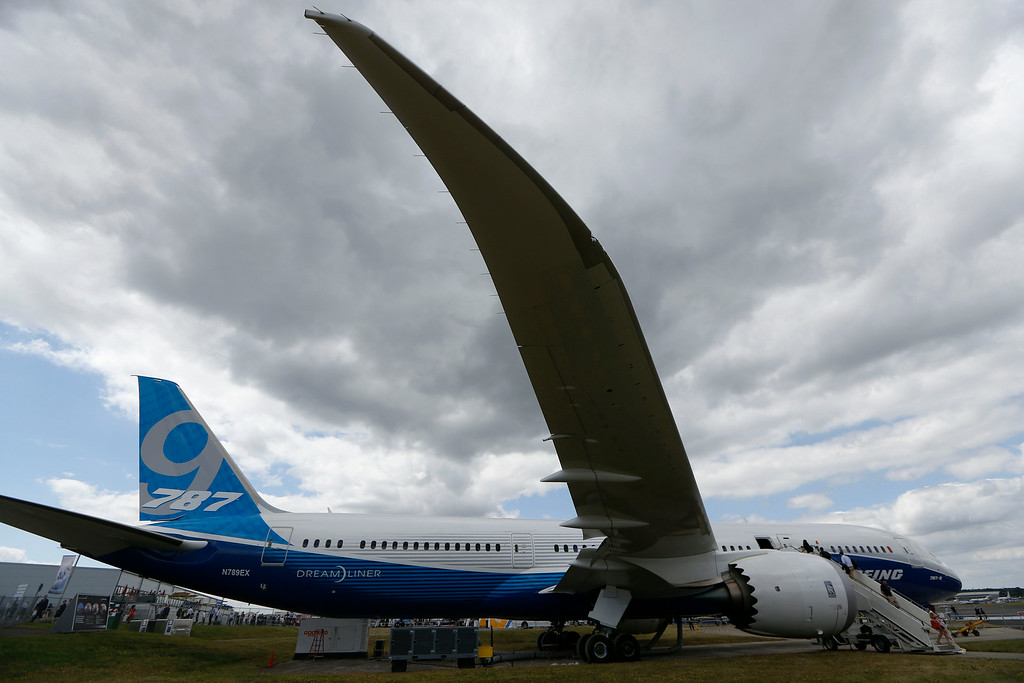 . Visitors walk on board a Boeing 787 on display during Farnborough International Air Show, Farnborough, England, Tuesday, July 15, 2014. (AP Photo/Sang Tan)