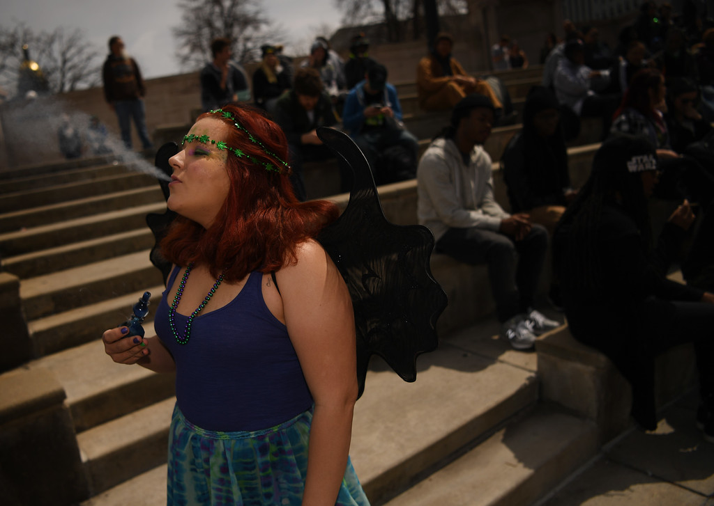 . Missy Rohn takes a hit at Civic Center Park in Denver, April 20, 2016. People gather at the park to celebrate the annual 420 day. (Photo by RJ Sangosti/The Denver Post)