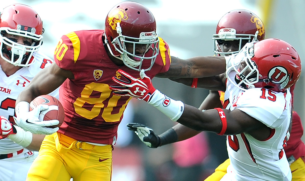 . Southern California wide receiver De\'Von Flournoy (80) catches a pass and pushes away from Utah defensive back Michael Walker (15) during the first half of an NCAA college football game in the Los Angeles Memorial Coliseum in Los Angeles, on Saturday, Oct. 26, 2013.  (Photo by Keith Birmingham/Pasadena Star-News)