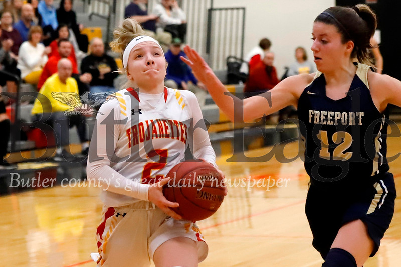 North Catholic's Emma Pospisil drives to the hoop against Freeport's Samantha Clark Thursday in the Trojanettes 61-42 home win. Seb Foltz/Butler Eagle