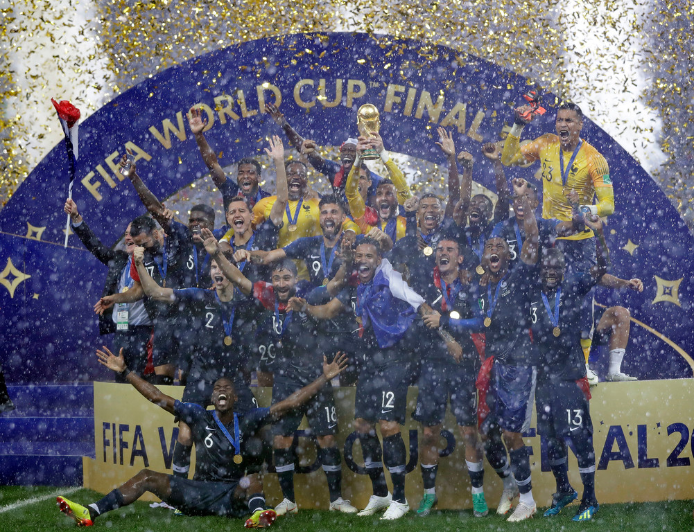 . France goalkeeper Hugo Lloris holds the trophy aloft after the final match between France and Croatia at the 2018 soccer World Cup in the Luzhniki Stadium in Moscow, Russia, Sunday, July 15, 2018. France won the final 4-2. (AP Photo/Matthias Schrader)