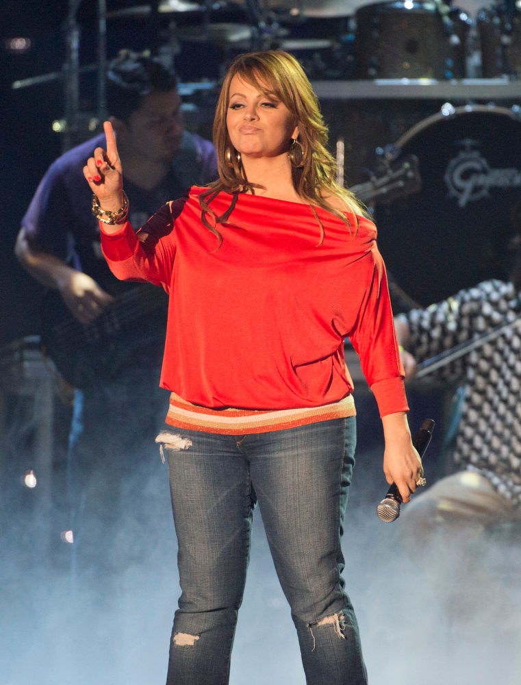 . This April 25, 2012 photo released by Telemundo shows Latin singer Jenni Rivera rehearsing for the 2012 Billboard Latin Music Awards,  at the BankUnited Center in Coral Gables, Fla.  The wreckage of a small plane believed to be carrying Mexican-American music superstar Jenni Rivera was found in northern Mexico on Sunday and there are no apparent survivors, authorities said. (AP Photo/Telemundo, Gary I Rothstein/Telemundo)