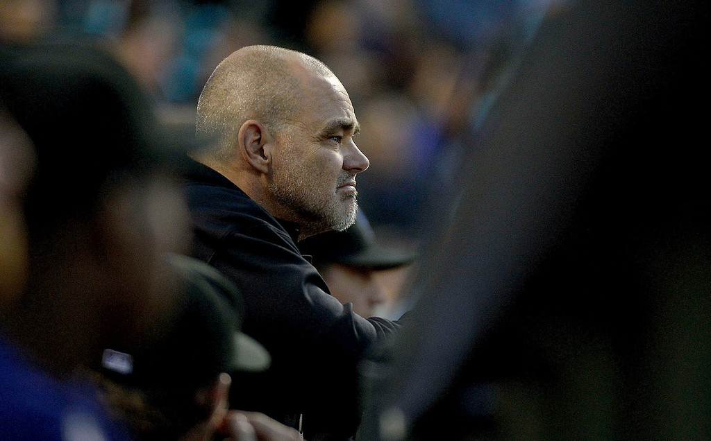 . DENVER, CO. - SEPTEMBER 24: Colorado Rockies hitting coach Dante Bichette watches from the dugout Boston Red Sox September 24, 2013 at Coors Field. Bichette announced he will resign as the teams hitting coach. (Photo by John Leyba/The Denver Post)