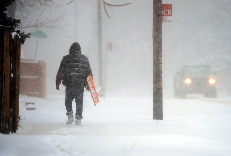 . A man walks along Evans Ave. near Wolcott Ct. in Denver Sunday morning, February 24th, 2013 during a heavy snowstorm.  (Photo By Andy Cross / The Denver Post)