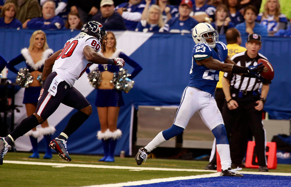 . Indianapolis Colts defensive back Vontae Davis (R) intercepts a pass in the end zone intended for Houston Texans wide receiver Andre Johnson (L) during the fourth quarter of an NFL football game in Indianapolis, Indiana December 30, 2012.   REUTERS/Brent Smith