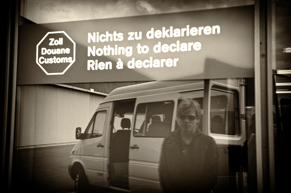 . July 14, 2011 - Jon Bon Jovi is reflected in the window at the airport in Zurich, Switzerland after arriving from Cologne, German during his band Bon Jovi\'s European tour leg on July 14, 2011.  (Photo credit: David Bergman / Bon Jovi)