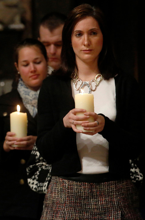 ". Jennifer Evans (R), a niece of one of the victims of the Lockerbie bombing, holds a memorial candle with other victims\' friends and relatives during a service of remembrance to mark the 25th anniversary of the Lockerbie bombing at Westminster Abbey in London December 21, 2013. Britain, the United States and Libya issued a joint call Saturday for justice over the Lockerbie bombing as services were held to mark the 25th anniversary of the attack, which claimed 270 lives. The three governments gave their ""deepest condolences\"" to relatives of those who died when Pan Am Flight 103 blew up over the Scottish town of Lockerbie on December 21, 1988, en route from London to New York.  AFP PHOTO / POOL / LUKE MACGREGOR/AFP/Getty Images"