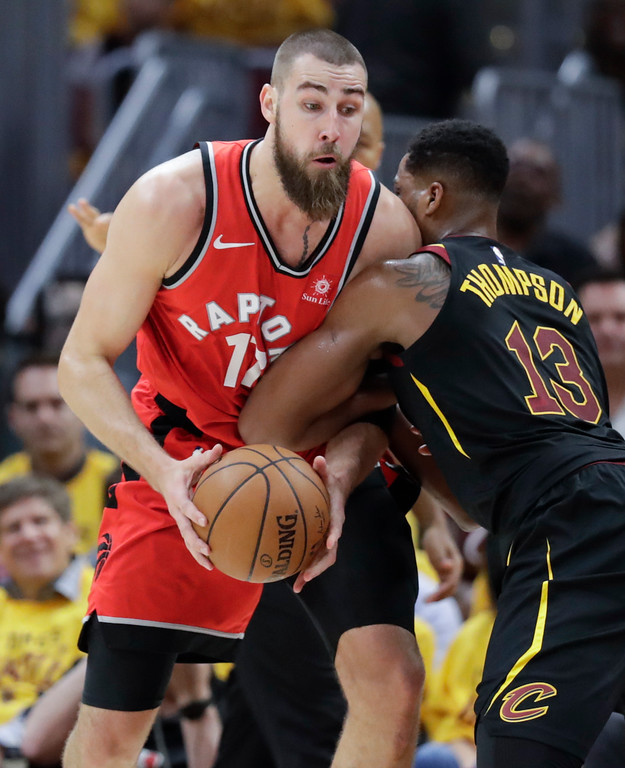 . Toronto Raptors\' Jonas Valanciunas, from Lithuania, attempts to go up for a shot against Cleveland Cavaliers\' Tristan Thompson (13) in the first half of Game 4 of an NBA basketball second-round playoff series, Monday, May 7, 2018, in Cleveland. (AP Photo/Tony Dejak)