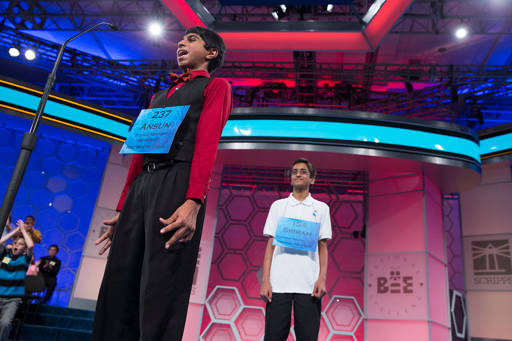". Ansun Sujoe, 13, of Fort Worth, Texas, left, reacts after spelling the word ""feuilleton\"" to be named co-champion of the National Spelling Bee with Sriram Hathwar, 14, of Painted Post, N.Y., on Thursday, May 29, 2014, in Oxon Hill, Md. (AP Photo/ Evan Vucci)"