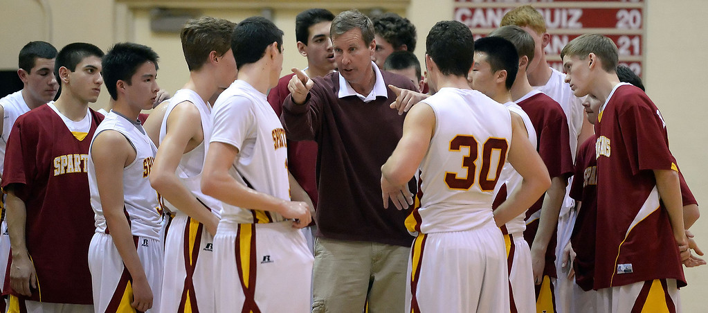 . La Canada head coach Tom Hofman during a time-out in the first half as they defeated La Salle 73-62 for coach Hofman\'s 600th win during a prep basketball game at La Canada High School in La Canada, Calif., on Friday, Jan. 10, 2014. Hofman record is 600 wins and 186 losses since becoming varsity head coach in the 1986-87 season. (Keith Birmingham Pasadena Star-News)