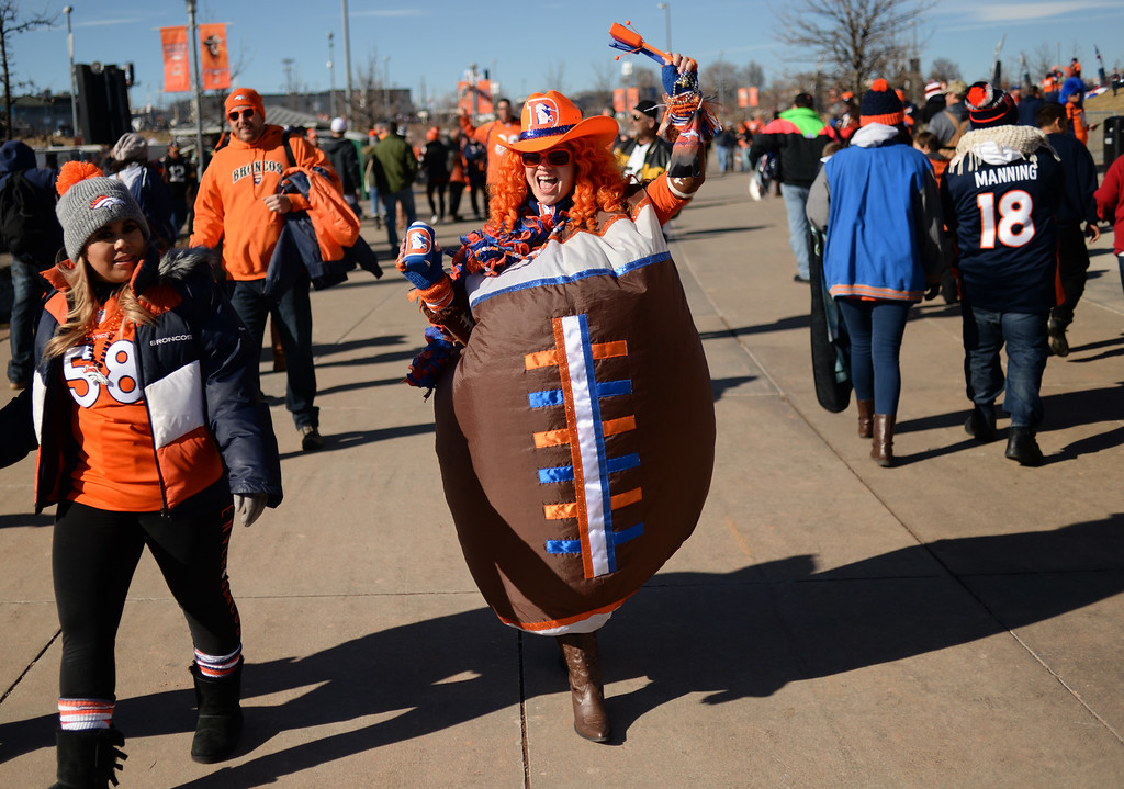 """. Crissy Nicole, \""""The Football Lady\"""" arrives at Sports Authority Field at Mile High for the Broncos game, January, 17, 2016. The Denver Broncos will take on Pittsburgh Steelers during AFC division playoff game. (Photo by RJ Sangosti/The Denver Post)"""