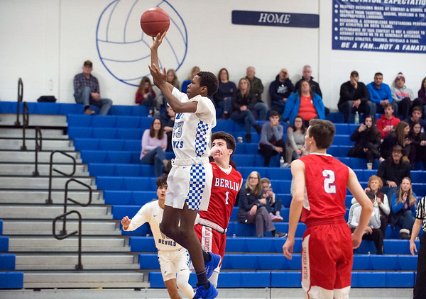 12/27/19 Wesley Bunnell | StaffrrBerlin boys basketball defeated Plainville on Friday night at Plainville High School. Plainville's Omarion Milla (23).