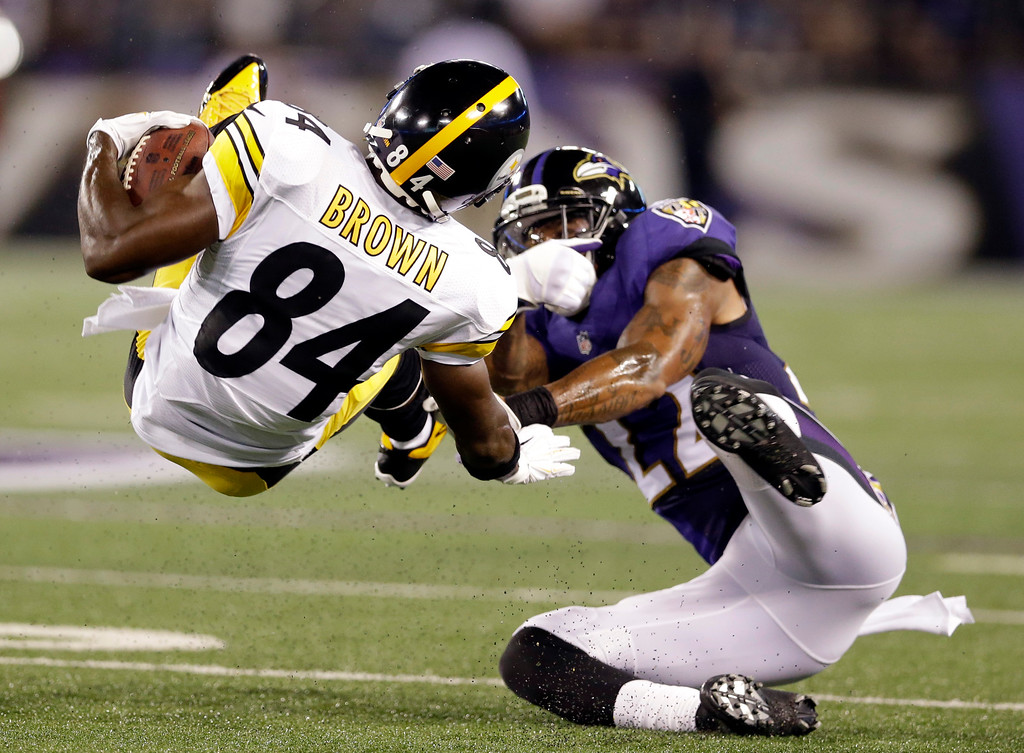 . Pittsburgh Steelers wide receiver Antonio Brown (84) is tackled by Baltimore Ravens cornerback Jimmy Smith (22) during the first half of an NFL football game Thursday, Sept. 11, 2014, in Baltimore. (AP Photo/Patrick Semansky)