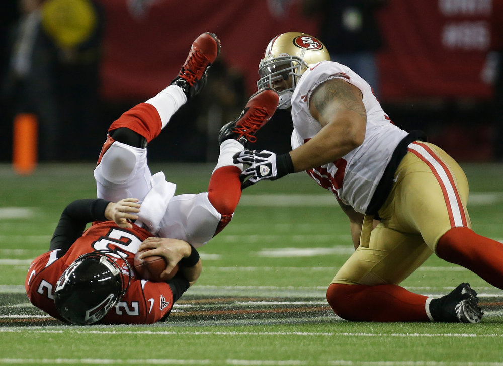 . Atlanta Falcons quarterback Matt Ryan is taken down by San Francisco 49ers\' Parys Haralson during the second half of the NFL football NFC Championship game Sunday, Jan. 20, 2013, in Atlanta. (AP Photo/Dave Martin)