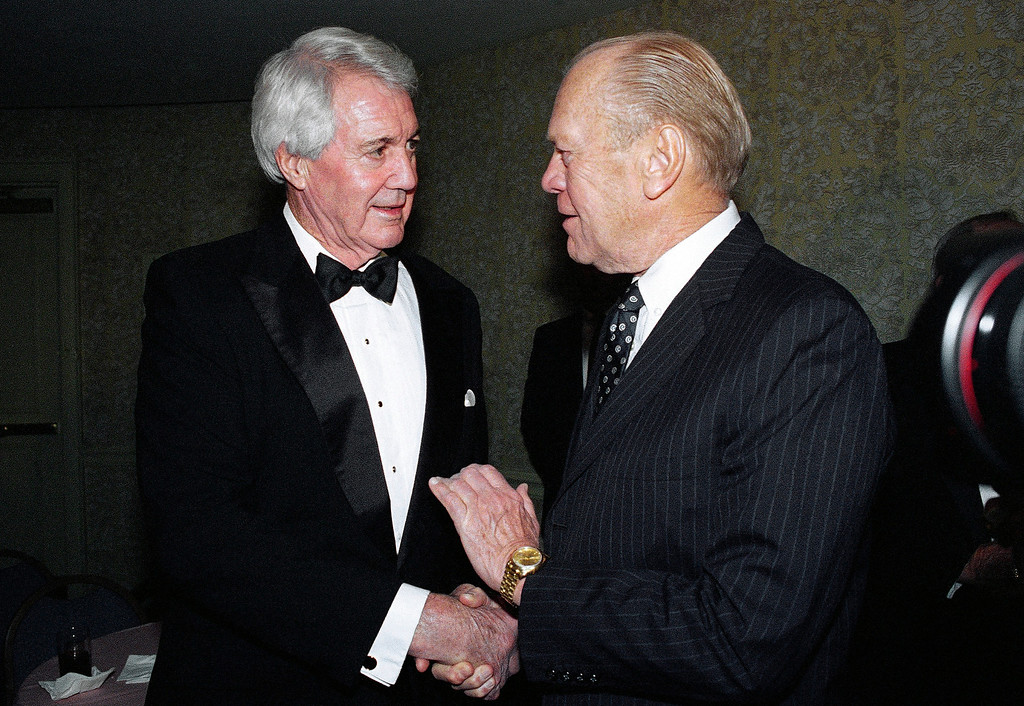 . FILE - In this Nov. 30, 1994, file photo, former President Gerald Ford, right, greets sportscaster Pat Summerall at a reception for the 10th annual American Sportscasters Hall of Fame Awards dinner in New York. Ford presented Summerall with the Sportscaster of the Year award at the dinner honoring the legendary voices of sports broadcasting and the achievements of sports legends. Fox Sports spokesman Dan Bell said Tuesday, April 16, 2013, that Summerall, the NFL player-turned-broadcaster whose deep, resonant voice called games for more than 40 years, has died at the age of 82. (AP Photo/Ron Frehm, File)