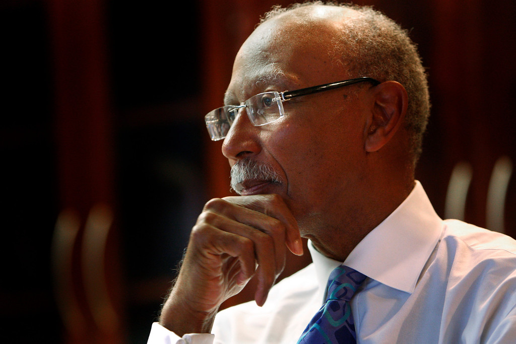 """. Detroit Mayor Dave Bing is seen during an interview in his office, Tuesday, Nov. 24, 2009. Bing\'s vision for Detroit over the next four years includes a leaner, less populated city perhaps dotted with urban farms. But Bing tells The Associated Press that the city has to avoid bankruptcy and still is in \""""free-fall\"""" due, in part, to a disastrous economy. (AP Photo/Carlos Osorio)"""