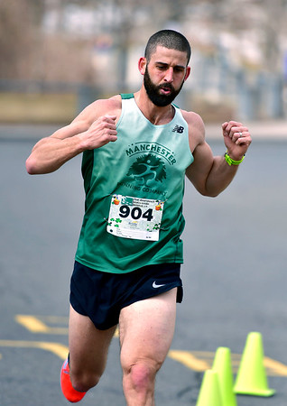 3/16/2019 MIke Orazzi | Staff Adam Gootnick take first place in the 5 Mile Run at the 17th Annual Shamrock Run & Walk at Chippens Hill Middle School on Saturday in Bristol.