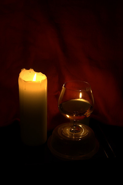 Candle and a glass of wine