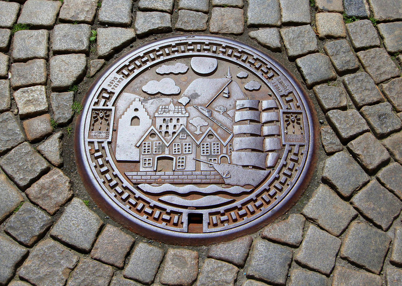 Pride shows in the manhole covers, works of art in Bergen. The covers in Stavanger were made the same way with local landmarks also featured.