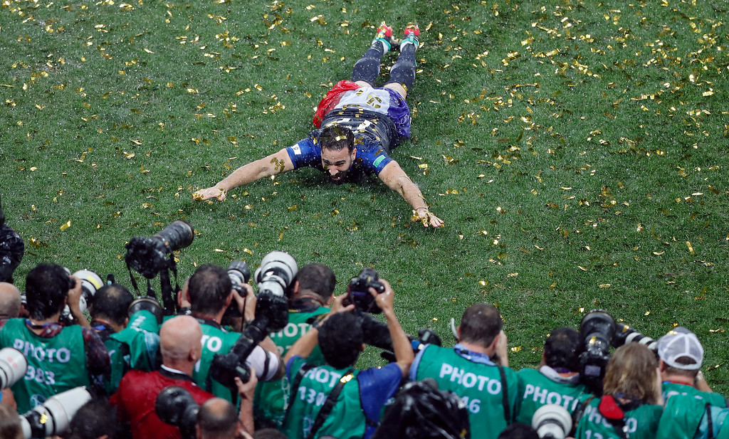 . France\'s Corentin Tolisso slides to celebrate after winning the final match between France and Croatia at the 2018 soccer World Cup in the Luzhniki Stadium in Moscow, Russia, Sunday, July 15, 2018. (AP Photo/Frank Augstein)
