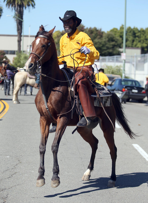 . Oakland Black Cowboy Association member Joseph Dougger gives a horsemanship demonstration during the 39th annual Oakland Black Cowboy Parade and Heritage Festival in Oakland, Calif., on Saturday, Oct. 5, 2013. The event also featured food, entertainment and pony rides for kids. The OBCA began in 1975 and educates the public about the role that black cowboys played in history and building of the west. (Jane Tyska//Bay Area News Group)