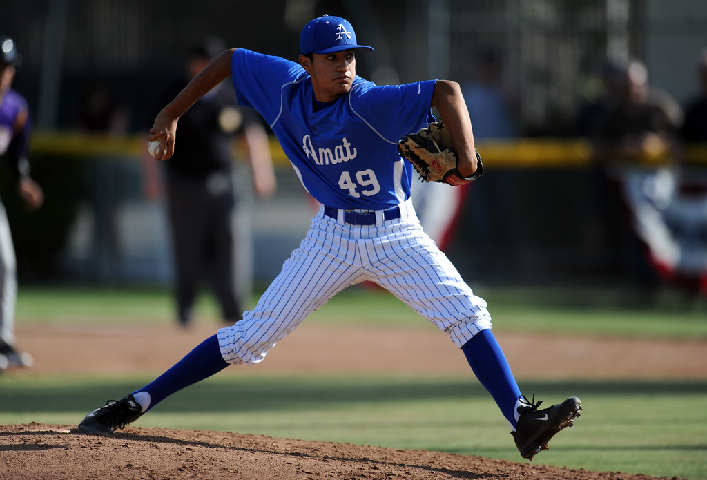 . Bishop Amat relief pitcher Alan Rodriguez throws to the pate in the sixth inning of a CIF-SS Division 3 first round playoff baseball game against Santiago at Bishop Amat High School on Wednesday, May 15, 2013 in La Puente, Calif. Bishop Amat won 12-3.  (Keith Birmingham Pasadena Star-News)