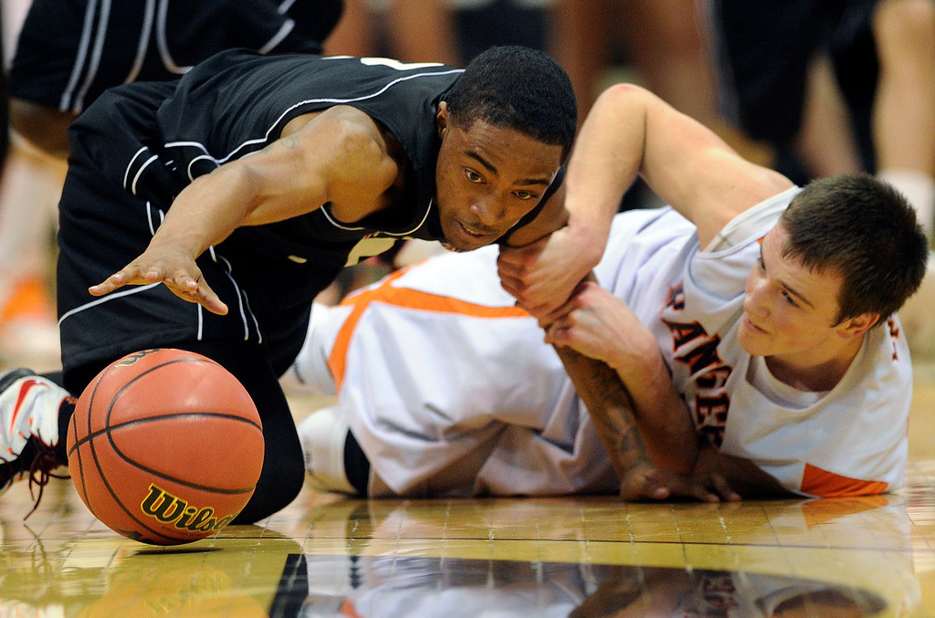 . BOULDER, CO. - MARCH 15: Wasson senior guard Angel Lingao (2) and Lewis-Palmer senior guard Tyler Ownes (35) went to the floor after a loose ball in the second half. The Lewis-Palmer High School boy\'s basketball team defeated Wasson 61-54 Friday night, March 15, 2013 at the Coors Events Center in Boulder.  The Rangers will meet Valor Christian in the 4A championship game Saturday. (Photo By Karl Gehring/The Denver Post)