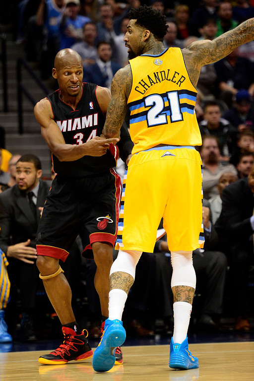 . Ray Allen (34) of the Miami Heat reacts to a possession call in the Denver Nuggets favor as Wilson Chandler (21) runs up court during the second half of Miami\'s 97-94 win.   (Photo by AAron Ontiveroz/The Denver Post)