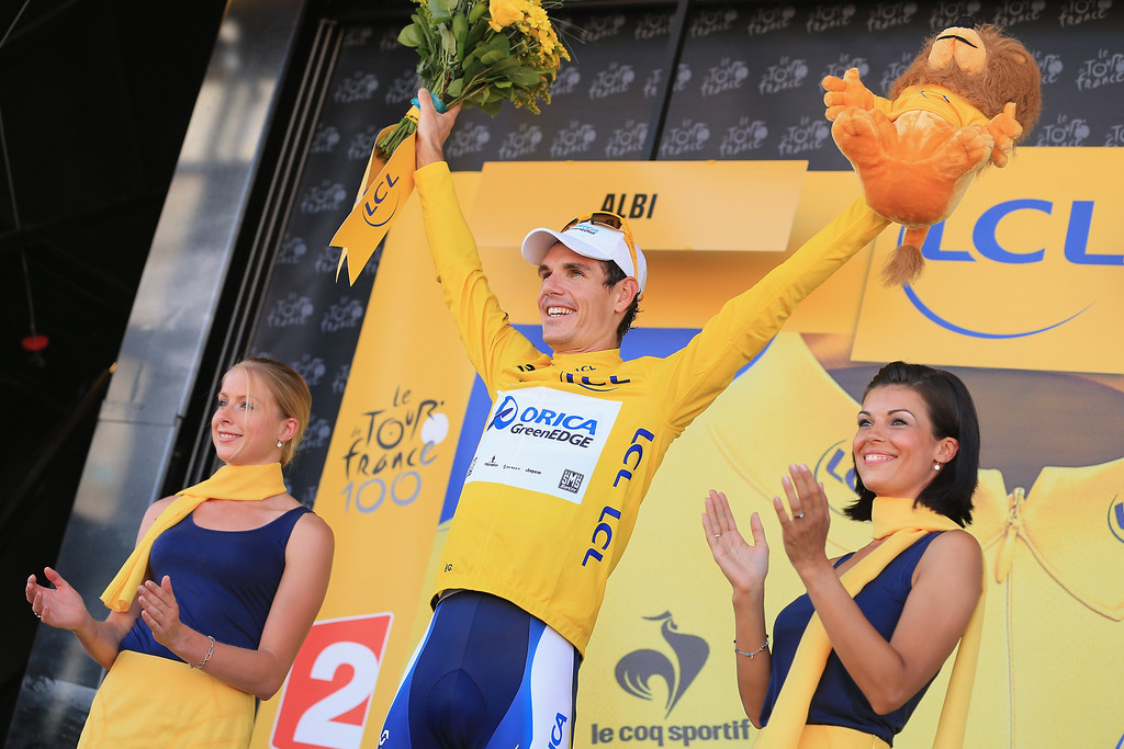 . ALBI, FRANCE - JULY 05:  Daryl Impey of South Africa riding for Orica-GreenEDGE takes the podium after defending the overall race leader\'s yellow jersey in stage seven of the 2013 Tour de France, a 205.5KM road stage from Montpellier to Albi, on July 5, 2013 in Albi, France.  (Photo by Doug Pensinger/Getty Images)