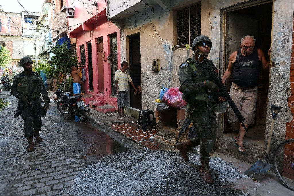 . Brazilian soldiers patrol Vila Pinheiro --part of the Mare shantytown complex near the Galeao (Antonio Carlos Jobim) international airport-- in the north suburb of Rio de Janeiro on April 5, 2014. Thousands of soldiers --including some 2,000 paratroopers, 450 sailors and 200 military police-- in armored vehicles, trucks and on foot entered one of Rio de Janeiro\'s most notorious slums to provide security less than three months before the World Cup and until July 30. CHRISTOPHE SIMON/AFP/Getty Images