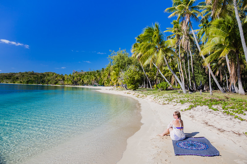 Lina Stock of the Divergent Travelers Adventure Travel Blog on a beach in the Yasawa Islands, Fiji