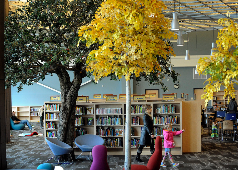 . The Anythink Library in Thornton opened in July of 2010. It has won innovation awards for it\'s service. It is located at 5877 E. 120th Ave.  Lyudmila Yevdokimova and her 5-year-old daughter Kseniya  Yevdokimova  of Commerce City walk through the trees in the  children\'s area on on Wednesday, November 23,  2011. Cyrus McCrimmon, The Denver Post
