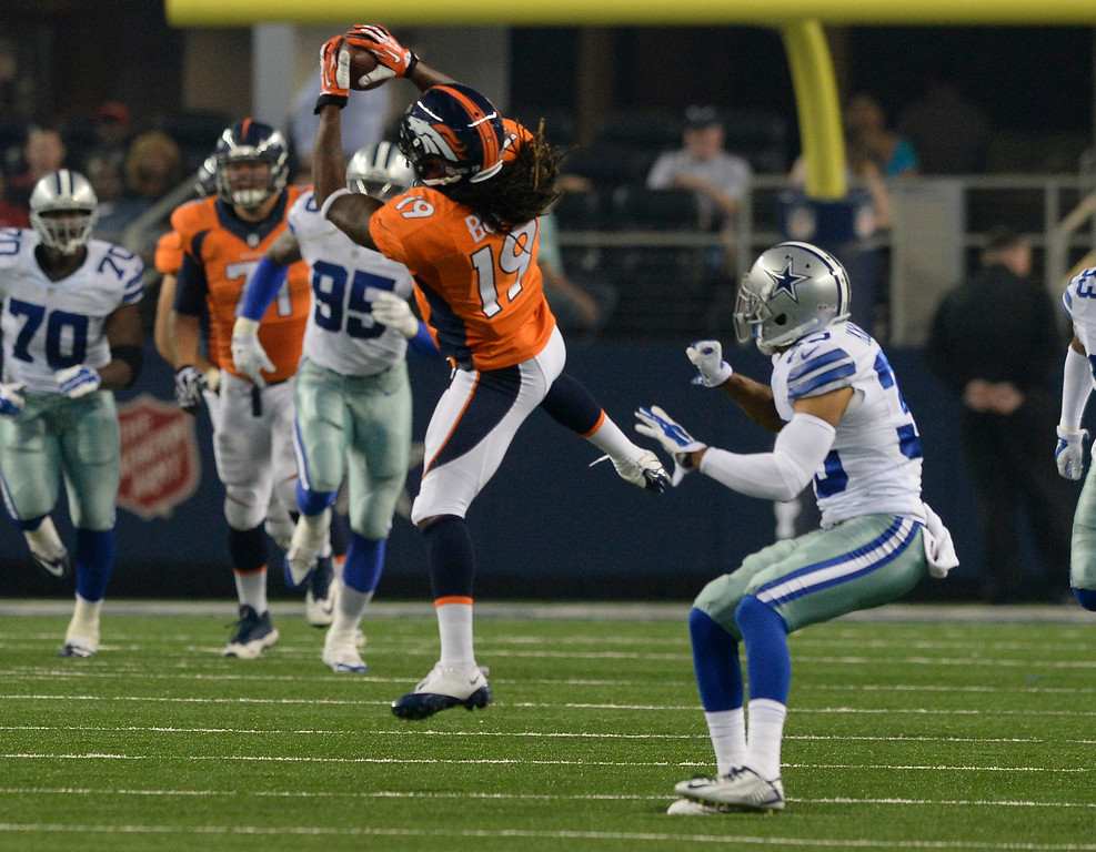 . ARLINGTON, TX - AUGUST 28: Denver Broncos wide receiver Isaiah Burse (19) goes up high for a catch in front of Dallas Cowboys defensive back Tyler Patmon (35) during the second quarter August 28, 2014 at AT&T Stadium. (Photo by John Leyba/The Denver Post)