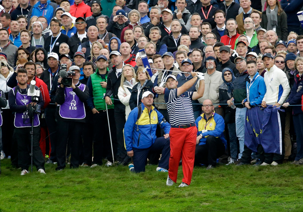 . Patrick Reed of the US plays a shot on the 1st fairway during his singles match against Europe�s Henrik Stenson on the final day of Ryder Cup golf tournament at Gleneagles, Scotland, Sunday, Sept. 28, 2014. (AP Photo/Matt Dunham)