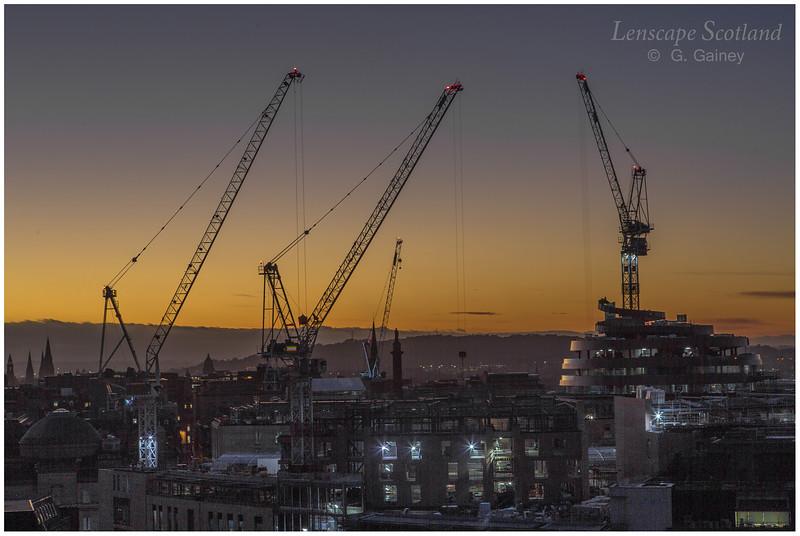 Saint James Quarter cranes from Calton Hill at dusk