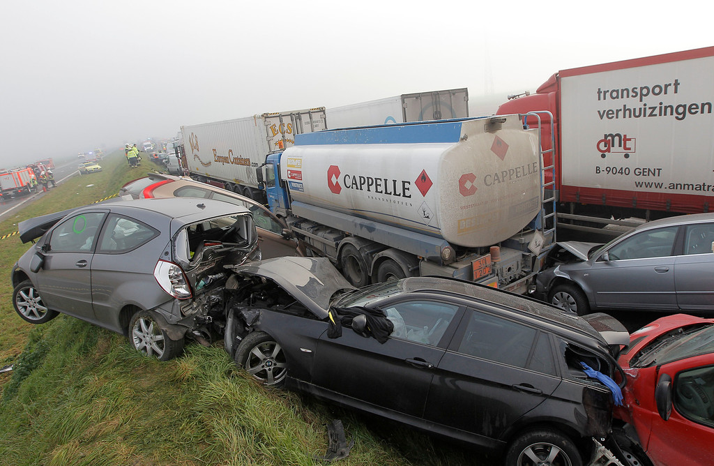 . Crashed cars sit on top of a shoulder on the A19 highway in Zonnebeke, western Belgium, Tuesday, Dec.3, 2013.  (AP Photo/Yves Logghe)