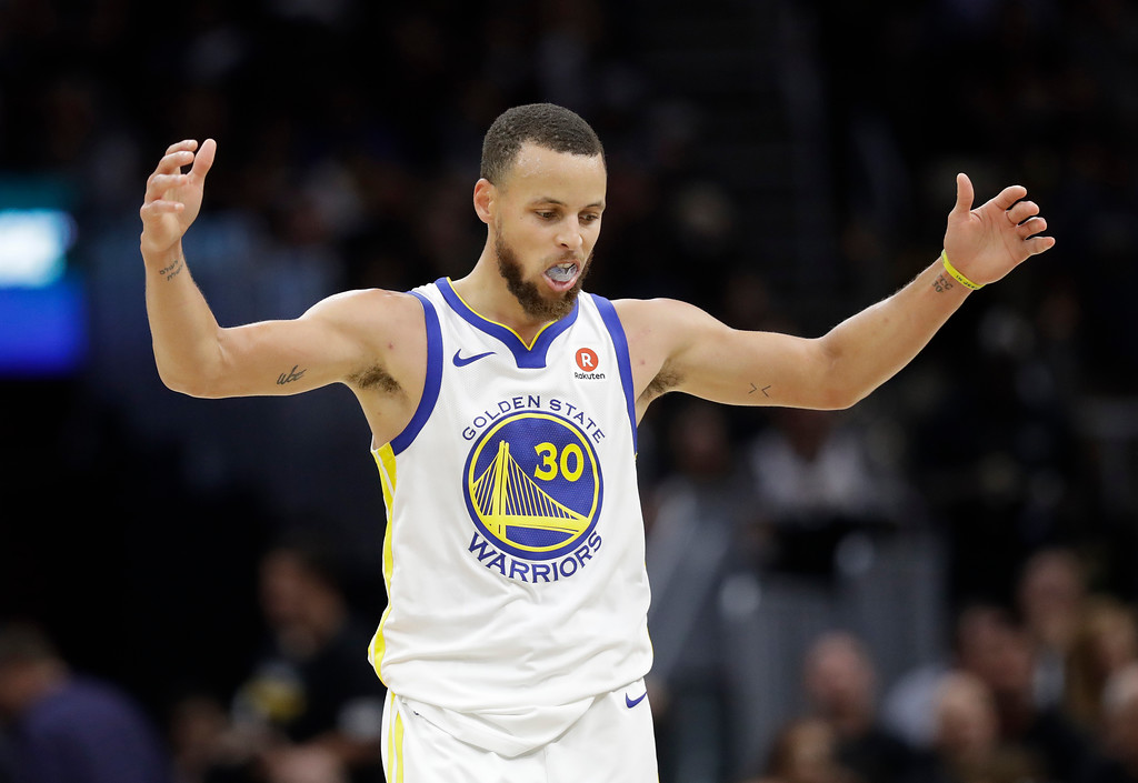 . Golden State Warriors\' Stephen Curry celebrates in the second half of Game 4 of basketball\'s NBA Finals against the Cleveland Cavaliers, Friday, June 8, 2018, in Cleveland. (AP Photo/Tony Dejak)
