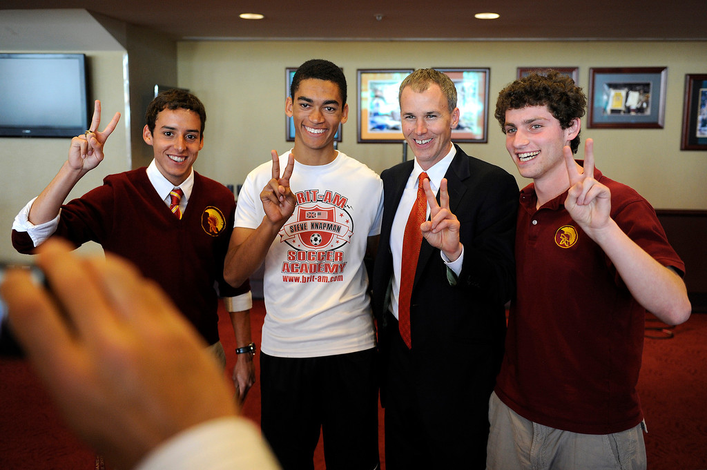. USC\'s new men�s basketball coach Andy Enfield has his picture taken with students following a press conference at Galen Center, Wednesday, April 3, 2013. (Michael Owen Baker/Staff Photographer)
