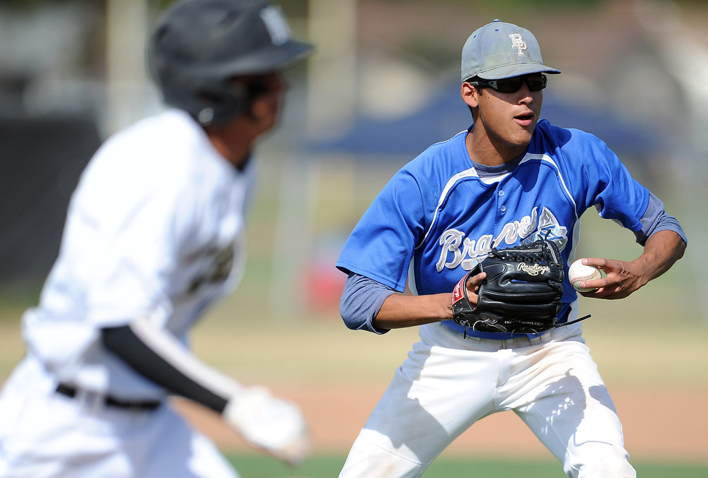 . Baldwin Park starting pitcher Bernardo Flores (C) tosses out Northview\'s Anthony Amaya in the third inning of a prep baseball game at Northview High School on Tuesday, April 23, 2012 in Covina, Calif. Northview won 8-2.    (Keith Birmingham/Pasadena Star-News)