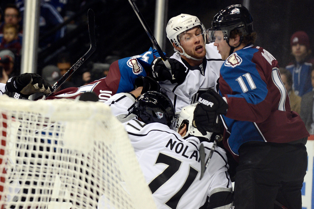 . DENVER, CO. - JANUARY 22: Los Angeles Kings defenseman Jake Muzzin (6) tangles with Colorado Avalanche left wing Jamie McGinn (11) and other players behind the goal during the first period. The Colorado Avalanche hosted the Los Angeles Kings at the Pepsi Center on January, 22, 2013.   (Photo By John Leyba / The Denver Post)