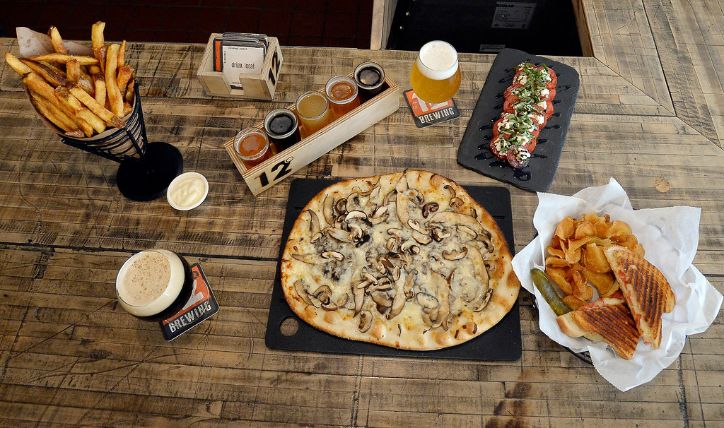 . LOUISVILLE, CO - November 14, 2018: Belgian beer with frites with garlic mayo, caprese salad, humongi fungi pizza, tomato cheddar panini, chocolate caramel and raspberry heart truffles, and a  beer flight at 12 Degree Brewery in Louisville.  (Photo by Cliff Grassmick/Staff Photographer)