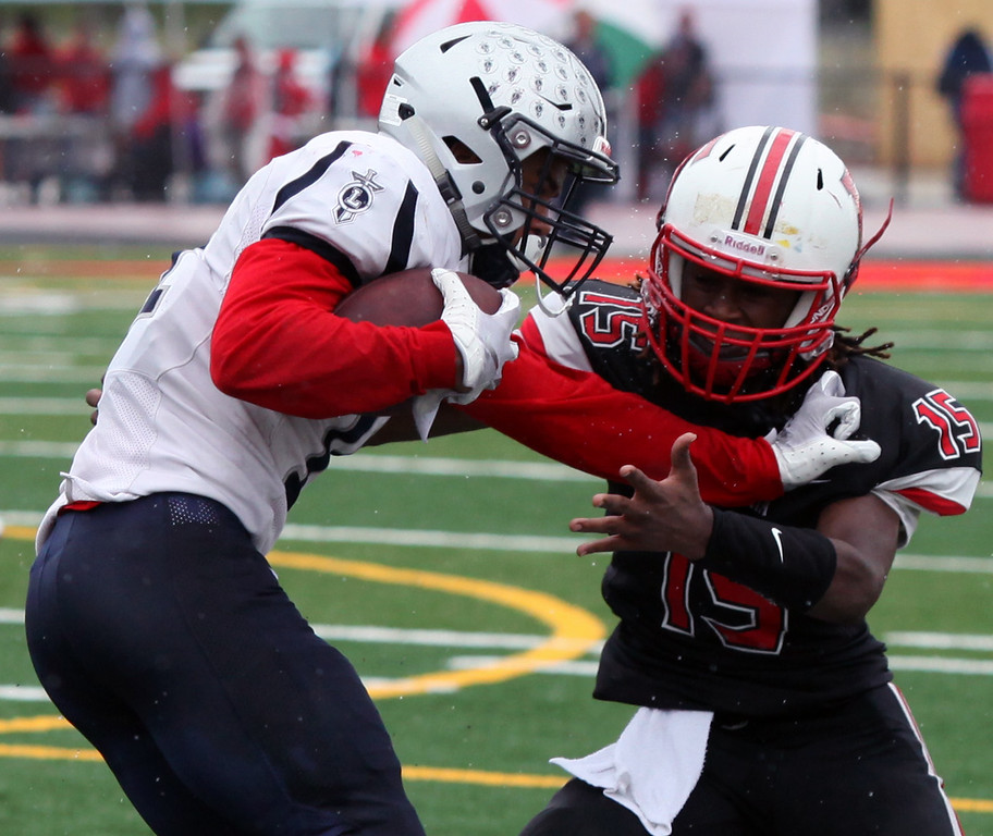 . Randy Meyers - The Morning Journal<br> Lorain running back Daylin Dower stiff arms Ty Allgood of Elyria for additional yardage during the second quarter on Sept. 8.