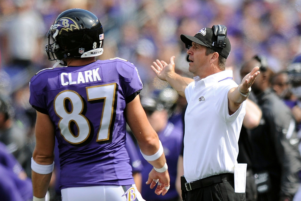 . Baltimore Ravens head coach John Harbaugh, right, reacts to action on the field during the first half of an NFL football game against the Cleveland Browns in Baltimore, Md., Sunday, Sept. 15, 2013. (AP Photo/Nick Wass)